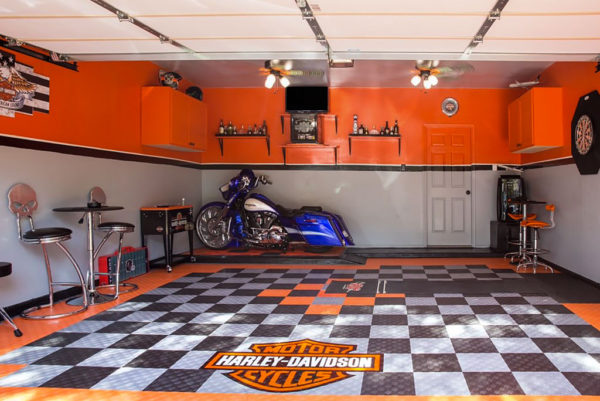 A garage with a custom bagger and Harley-Davidson garage floor tiles