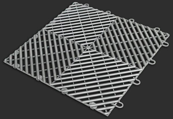 A Free-Flow garage floor tile in alloy