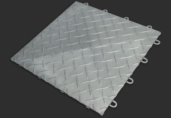 A RaceDeck Diamond garage floor tile in alloy