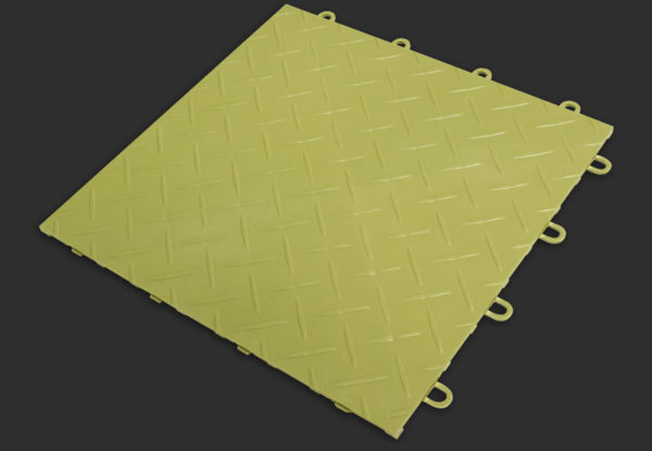 A RaceDeck Diamond garage floor tile in green light