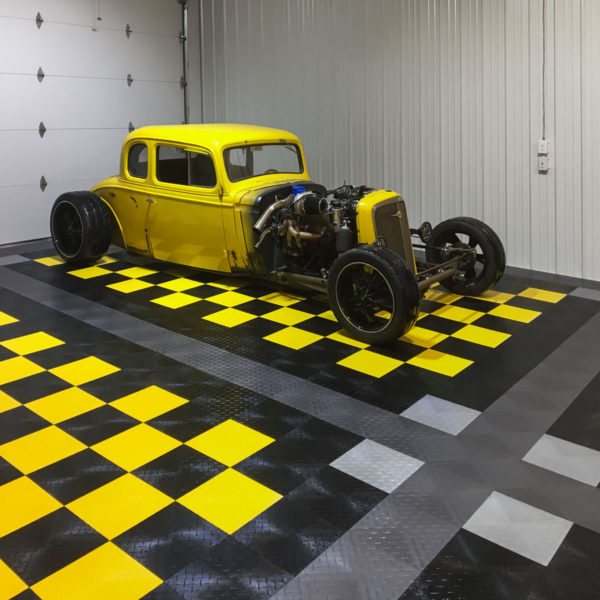 A yellow rat rod on a yellow and black checkerboard pattern.
